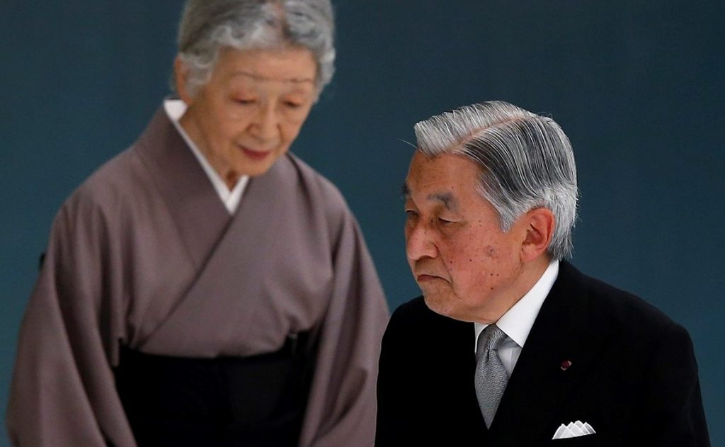 Japan's Emperor Akihito (R) and Empress Michiko attend a memorial service ceremony marking the the 69th anniversary of Japan's surrender in World War Two, at Budokan Hall in Tokyo August 15, 2014. Japanese Prime Minister Shinzo Abe on Friday sent a ritual offering to the Yasukuni Shrine to war dead but did not join senior government officials in a visit, a decision meant to avoid inflaming ties with Beijing as he seeks a Sino-Japanese summit. REUTERS/Toru Hanai (JAPAN - Tags: POLITICS CONFLICT ANNIVERSARY ROYALS) - RTR42HVQ
