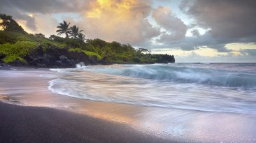 Waves-crashing-black-sand-beach-Hawaii