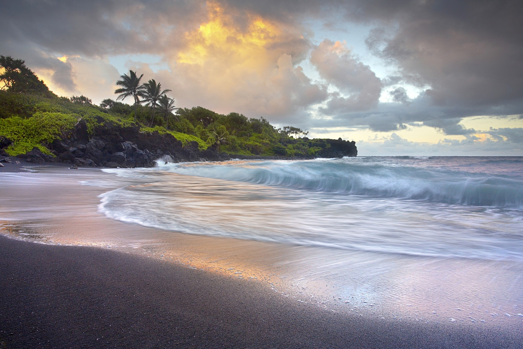 Waves-crashing-black-sand-beach-Hawaii